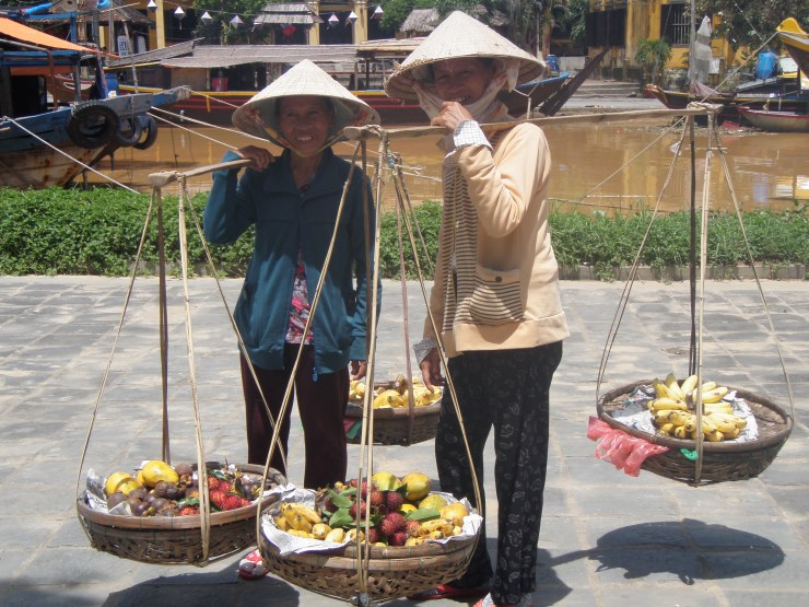 Vietnamese street food sellers hanging baskets