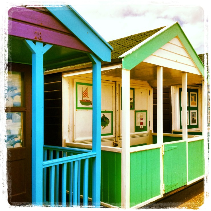 green blue beach hut southwold