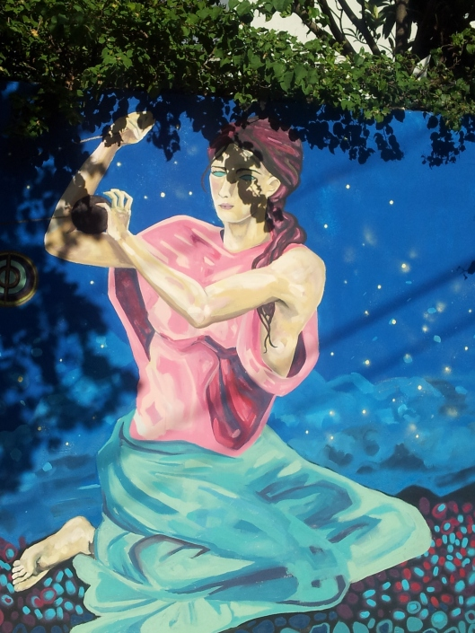 pink blue lady in tree Buenos Aires street art