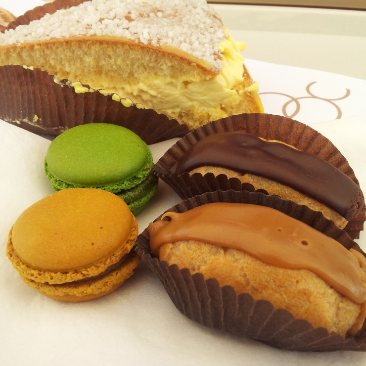 French patisserie dessert macarons, eclairs, Tropezienne