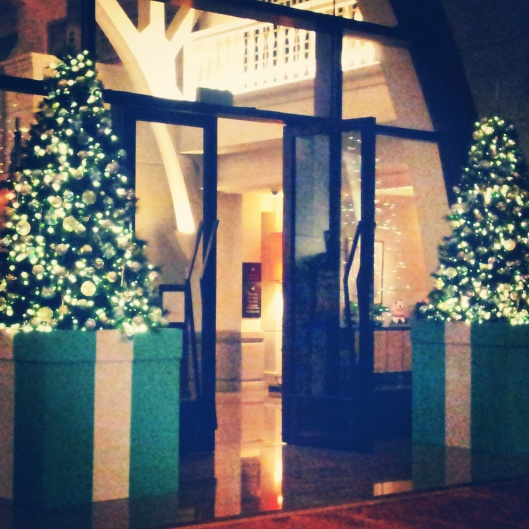 blue gift boxes Christmas trees outside Fullerton Bay hotel Singapore