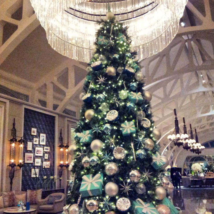 Christmas tree under chandelier Fullerton Bay Hotel Singapore