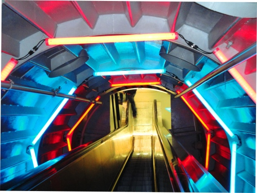 blue red lights escalator Atomium Brussels tourist attraction