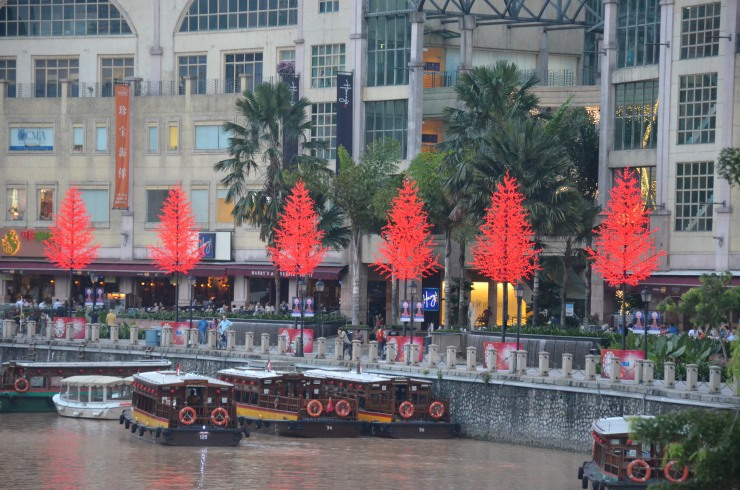red Christmas trees lit up Clarke Quay Singapore