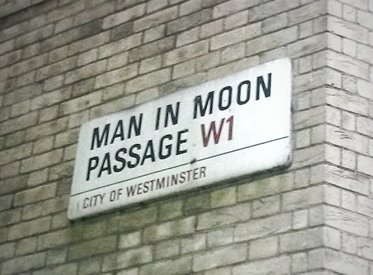 Man in moon passage London street sign