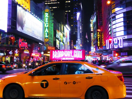 Times Square yellow taxi neon lights