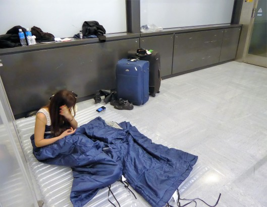 sleeping bag airport floor