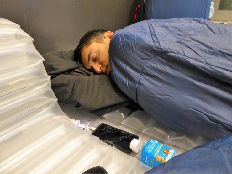 sleeping bag airport floor
